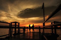 Sunset at with people of silhouette. Sunset  at  port  of Bangkok  near rivere with  people  silhouette Royalty Free Stock Photo