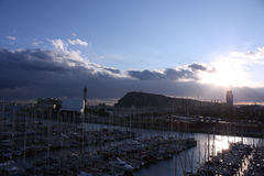 Sunset in port of Barcelona. Panoramic city Stock Photo