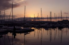 Sunset in the port stock image