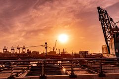 Sunset in a port. Sunset in a cargo transport port on the Chilean coasts stock image