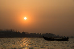 Sunset at the port of Chittagong, Bangladesh. Sunset at the port with many boats in the center of Chittagong in Bangladesh Stock Images
