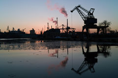Sunset in the port of Gdansk. Winter day in the port of Gdansk is coming to an end Royalty Free Stock Photos