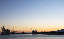 Sunset at a port Stock Image