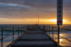 A sunset from on the Port Noarlunga Jetty in Port Noarlunga South Australia on 12th September 2018. A sunset from on the Port Noarlunga Jetty in Port Noarlunga stock photo