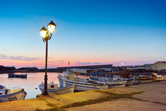 Sunset at the port of Sozopol town Stock Photo