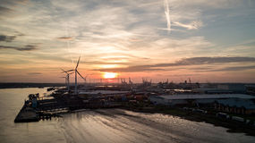 Sunset at the Port of Tilbury, Essex, UK. Aerial drone view of the port of Tilbury in Essex, England, with wind turbines and cranes dominating the skyline Stock Photography