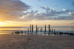 Sunset at Port Willunga Beach, South Australia. Featuring the old jetty ruins, affectionately known as the sticks by locals Stock Photo