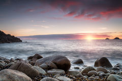 Sunset at Porth Nanven Cove in cornwall Stock Photos
