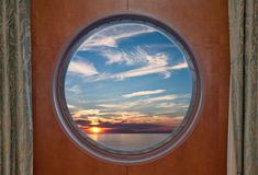 Sunset Through Porthole Stock Images