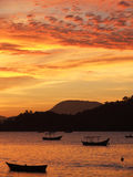 Sunset in Porto Belo. Sunset with fisherboats in the foreground in the bay of Porto Belo - Brazil Stock Photography