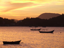 Sunset in Porto Belo. Sunset with fisherboats in the foreground in the bay of Porto Belo - Brazil Royalty Free Stock Image
