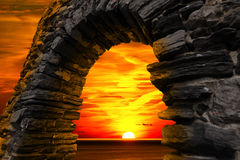 Sunset in Portovenere - Liguria Italy. Sunset over the sea with cloudy sky, seen through a stone window in Portovenere (UNESCO world heritage site) - La Spezia Royalty Free Stock Photos