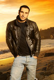 Sunset Portrait. Full body portrait of good looking man in golden light wearing a leather jacket against beautiful sunset Royalty Free Stock Photos