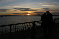 Couple watching at a sunset Royalty Free Stock Images