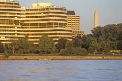 Sunset on the Potomac River, Watergate Building and the National Monument, Washington, DC Royalty Free Stock Photo