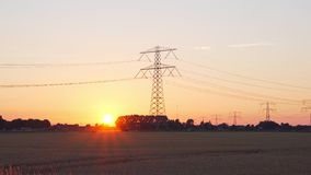 Sunset and power line. Hand held stock footage