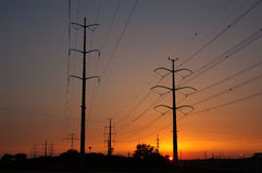 Sunset with power lines Stock Photos