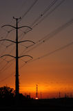 Sunset with power lines Royalty Free Stock Photos
