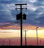 Sunset and telephone poles stock photography