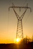 Sunset Powerlines. Powerlines extend to the horizon at sunset stock photo