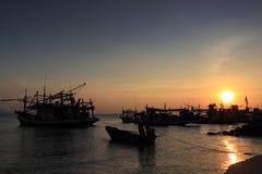 Sunset at prachuap bay,thailand. And fishing boat Royalty Free Stock Photo