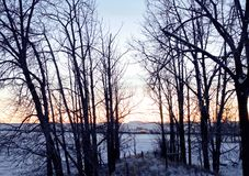 Sunset on the Prairies. Sunset over the Canadian Rockies on winter farmland Stock Photo