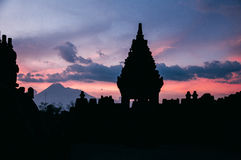 Sunset at Prambanan Temple. The photo is shot at sunset at Prambanan Temple.It's a famous hinduism word heritage site near Yogyakarta. Mount Merapi is in the Stock Image