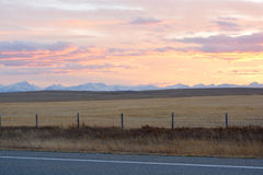 Sunset On Prairies. Pastel sunset on praries with rocky mountains in background Stock Photos
