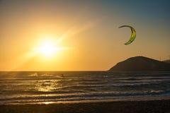 Sunset on Prasonisi beach with kitesurfer Rhodes, Greece stock images