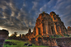 Sunset at Pre Rup Angkor Cambodia. With high contrast cloudy skies royalty free stock photo