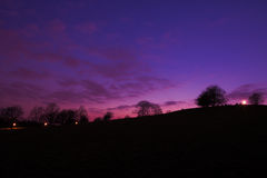 Sunset at Primrose Hill. Purple sunset at Primrose Hill Park in London England UK Royalty Free Stock Photo