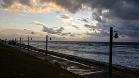 Sunset, on promenade of Mediterranean Sea, winter, Haifa, Israel. Beauty sunset, nobody coastline of Mediterranean Sea, cold winter, Haifa, Israel Stock Photo
