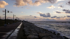 Sunset, on promenade of Mediterranean Sea, winter, Haifa, Israel. Beauty sunset, nobody coastline of Mediterranean Sea, cold winter, Haifa, Israel Stock Images