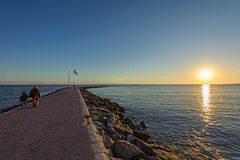 Sunset promenade with walking people at Marbella town, Andalusia, Spain Royalty Free Stock Images