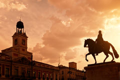 Sunset in Puerta del Sol, Madrid. With Casa de Correos at the left and the equestrian statue of Carlos III at the right Royalty Free Stock Photos