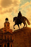Sunset in Puerta del Sol, Madrid. With Casa de Correos at the left and the equestrian statue of Carlos III at the right Royalty Free Stock Photography