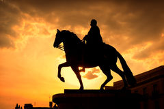 Sunset in Puerta del Sol, Madrid. With the equestrian statue of Carlos III at the right Royalty Free Stock Photos