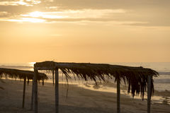 Sunset on Punta Sal beach with wooden shelters, Peru Royalty Free Stock Photography