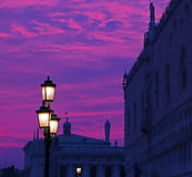 Sunset purple and lanterns lit street in Venice, Italy 1 Stock Images