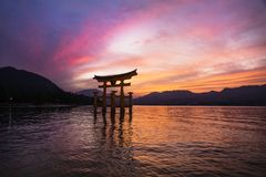Sunset at the Floating Torii gate in Miyajima, Japan. Stock Image