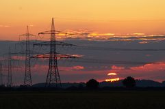 Sunset and pylons Stock Images