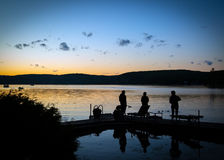 Sunset in Québec, Canada. Sunset by a lake in Québec,Canada. Saint-Hyppolite. Few people relaxing on the dock. The end of a nice summer day Royalty Free Stock Photos