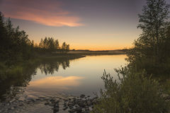 Sunset. In a quiet and calm lake in Finland stock photo