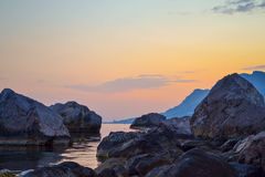 Sunset between stones in Crimea Royalty Free Stock Photos