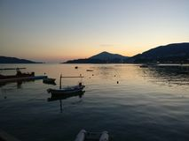 Sunset in Rafailovici. Montenegro. Budvanska Riviera.  3-5 km from Budva. Boats, fishermen went home Royalty Free Stock Photos