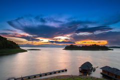 Before sunset with raft on Srinagarindra dam, Kanchanaburi. Thailand: Long exposure, visible noise due to high ISO, soft focus, shallow DOF, slight motion blur Royalty Free Stock Images