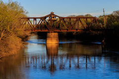 Sunset at a railroad crossing over the Little Red River. stock photography