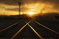 At sunset railway. Golden the setting sun,The tracks also sends out a golden。This picture was taken in the summer,Is the northwest China stock image