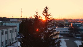 Sunset on railway station, Russian Railways. Sunlight at fir tree branches, snow stock footage