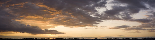Sunset after rain. Panoramic effect compound from three photos (without use of tripod stock images